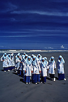 Like sea gulls on the Beach, Muslim school children on a beach in Brunei during a school outing