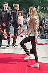 Aug. 3, 2012 - Manhattan, New York, U.S. - For a Michael Kors fashion ad shoot, a young woman wearing gold and black makes a Red Carpet entrance, photographed by paparazzi while walking up steps in front of New York Public Library entrance at 5th Avenue & 42nd Street.
