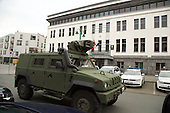 An armoured car parked in front of the central police station in Brussels' Molenbeek neighbourhood, a hotbed of Islamic fundamentalism.