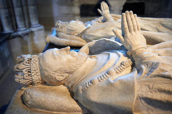Tomb of (foreground) King Henry II of France (1519 - 1559) second son of Francis I and Catherine de Medici (1519 - 1589) daughter of Lorenzo II de Medici. The Gothic Cathedral Basilica of Saint Denis ( Basilique Saint-Denis ) Paris, France. A UNESCO World Heritage Site.
