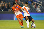 11 December 2015: Clemson's Iman Mafi (NOR) (7) and Syracuse's Noah Rhynhart (12). The Clemson University Tigers played the Syracuse University Orange at Sporting Park in Kansas City, Kansas in a 2015 NCAA Division I Men's College Cup Semifinal match. The game ended in a 0-0 tie after overtime; Clemson advanced to the Final by winning the penalty kick shootout 4-1.