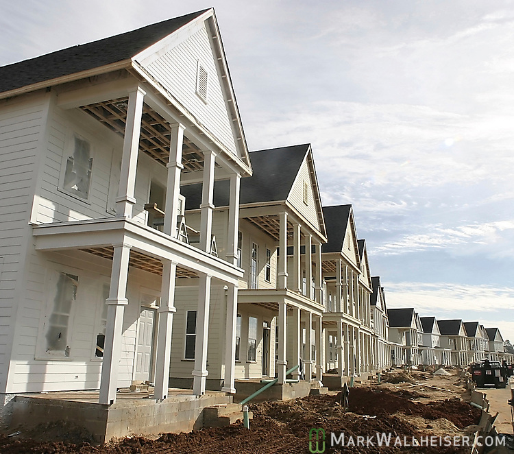 32 Garden District Houses being built on Longfellow Rd. in the St Joe development Southwood Plantation in Tallahassee, Florida.