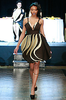 "Model walks runway in an outfit from the ""Flavour of Coffee"" collection by Annamaria Kiss Kosa, during Slovak Fashion Night 2012 in New York City May 11, 2012."