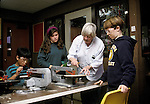 Albany CA Elderly volunteer teacher instructing students in wood working techniques