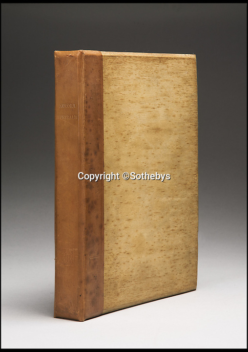 BNPS.co.uk (01202 558833)<br /> Pic: Sothebys/BNPS<br /> <br /> ***Please Use Full Byline***<br /> <br /> An exterior shot of the book, showing the wooden covers.<br /> <br /> An incredibly rare copy of the first book published on the Antarctic continent by Ernest Shackleton's expedition team has emerged for sale.<br /> <br /> Experts have described the copy of Aurora Australis as the finest in existence - and have tipped it to fetch upwards of 60,000 pounds when it goes under the hammer.<br /> <br /> The book was produced by Shackleton's men in 1908 during the Nimrod Expedition as a way to stave off boredom during the long winter nights at their remote base camp at Cape Royds on Ross Island.
