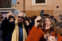 Roma 20 Marzo 2015<br /> Eclissi solare parziale al quartiere San Lorenzo. La gente si riunita questa mattina in Piazza Immacolata, per osservare  l'eclissi solare parziale. Alcune persone guardano  l'eclissi solare parziale attraverso una radiografia.<br /> <br /> Rome March 20, 2015<br /> Partial solar eclipse. People gather this morning in Piazza Immacolata, District San Lorenzo, to get a rare glimpse of the solar eclipse. People looks at a partial solar eclipse through an X-ray<br /> .