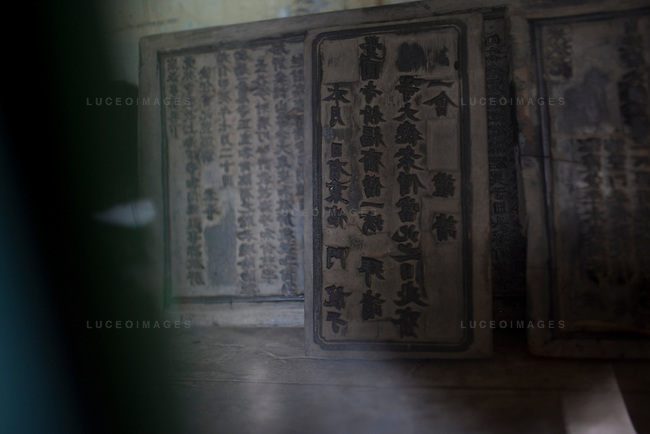 Engraving plates that used to be used to print Sutras, or Buddhist scriptures, are now looked behind a glass case at the Giac Vien Pagoda in District 11 in Ho Chi Minh City, Vietnam. Pagoda monks say the plates are more than 200 years old. Photo taken Monday, May 3, 2010...Kevin German / LUCEO
