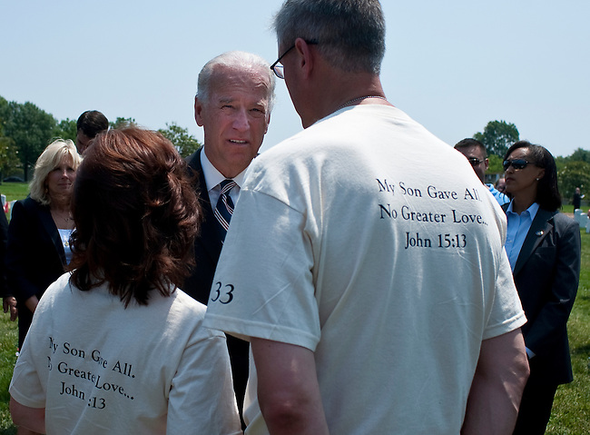 May 31, 2010 - Washington, District of Columbia, U.S., - Vice President Joe Biden pauses to talk to family and friends of fallen soldiers during his visit Arlington National Cemetery on Memorial Day.(Credit Image: &copy; Pete Marovich/ZUMA Press)
