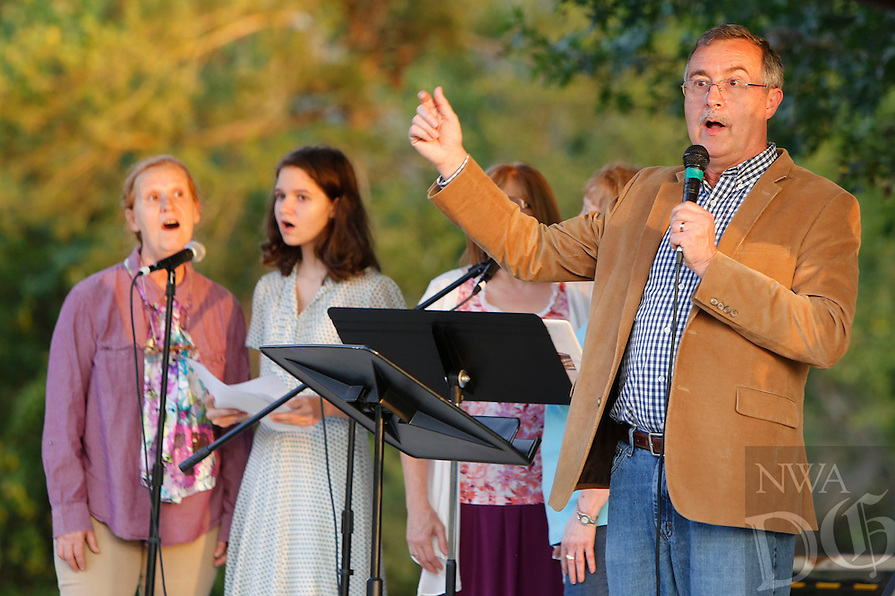 NWA Democrat-Gazette/DAVID GOTTSCHALK  Danny Reding (cq) (right) sings Monday, September 28, 2015 with the First Baptist Church of Elkins Praise Team during Gather at the River, a celebration at Bunch Park in Elkins. The event took place over three nights sharing a message, music and community.