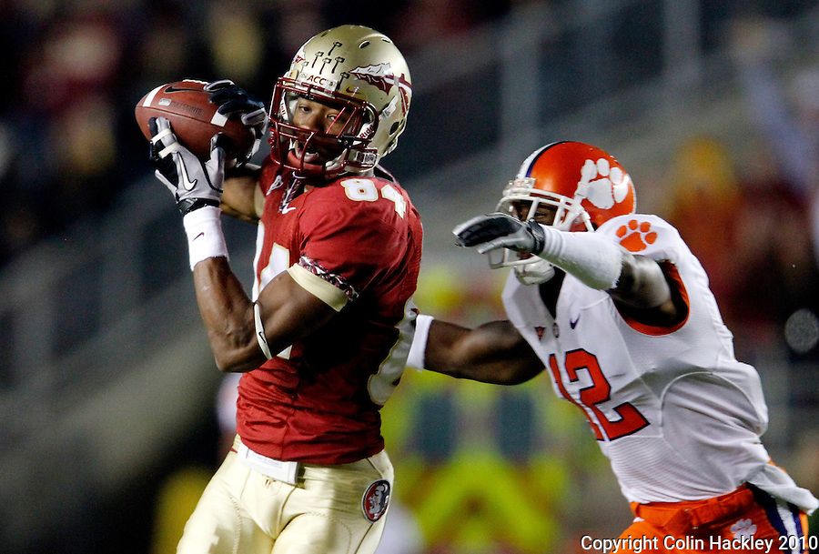 TALLAHASSEE, FL 11/13/10-FSU-CLEMSON FB10 CH-Florida State's Rodney Smith pulls down a 53-yard pass as Clemson's Marcus Gilchrist closes during first quarter action Saturday at Doak Campbell Stadium in Tallahassee. .COLIN HACKLEY PHOTO
