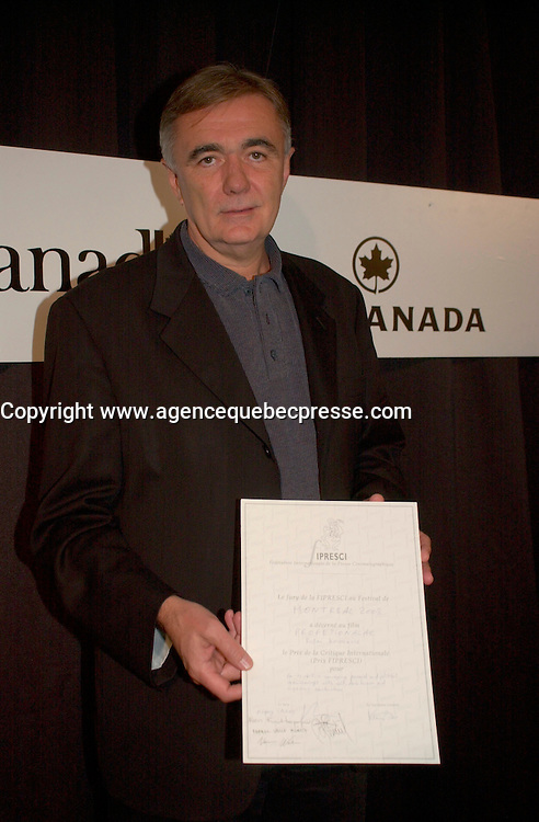 Sept 7,  2003, Montreal, Quebec, Canada<br /> <br /> Serbian-Montenegro film maker Dusan Kovacevic after receiving an the FIPRESCI AWard for his movie THE PROFESSIONAL (PROFESIONALAC) <br /> <br /> <br /> The Festival runs from August 27th to september 7th, 2003<br /> <br /> <br /> Mandatory Credit: Photo by Pierre Roussel- Images Distribution. (&copy;) Copyright 2003 by Pierre Roussel <br /> <br /> All Photos are on www.photoreflect.com, filed by date and events. For private and media sales