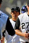 26 August 2007:  Colorado Rockies second baseman Kazuo Matsui (center), gets congratulations from teammates after a game against the Washington Nationals at Coors Field in Denver, Colorado. The Rockies defeated the Nationals 10-5 to sweep the 3-game series...Mandatory Photo Credit: Ed Wolfstein Photo