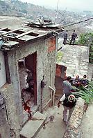 Urban violence in Rio de Janeiro, Brazil. Drug traffic war in shantytown. Death, murder, blood, police.