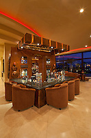 Large wetbar is seen in modern luxury home at night