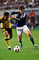 (R-L) Gotoku Sakai (JPN), Mahali Jasuli (MAS), SEPTEMBER 21, 2011 - Football / Soccer : 2012 London Olympics Asian Qualifiers Final Round Group C match between U-22 Japan 2-0 U-22 Malaysia at Tosu Stadium in Saga, Japan. (Photo by Jinten Sawada/AFLO)