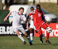 Matthew Dunn (5) of the United States tries to catch up to Alexander Gonzales (20) of Panama during the group stage of the CONCACAF Men's Under 17 Championship at Jarrett Park in Montego Bay, Jamaica. The USA defeated Panama, 1-0.