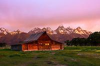 Moulton Barn at sunrise on Mormon Row against the Teton Range Mountains in Grand Teton National Park.