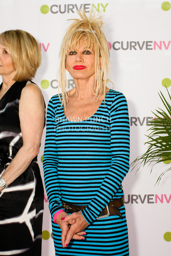 Betsey Johnson on stage at the CURVE and CFDA Party For A Cause event during the CURVENY Lingerie &amp; Swim show, at the Jacob Javits Convention Center, August 2, 2010.