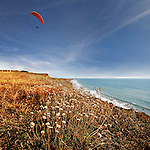 Paragliding at Compton Bay, along the south-west coast of the isle of wight
