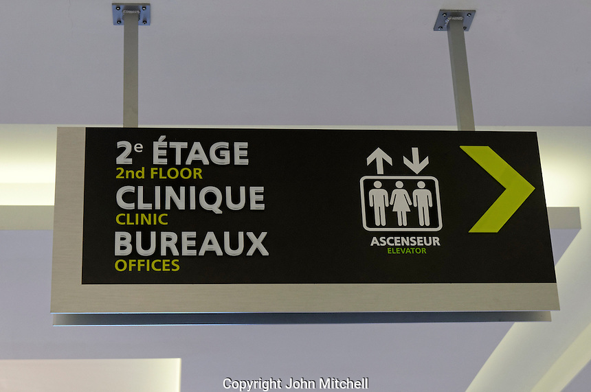 Bilingual French and English direction sign in a shopping centre in Montreal, Quebec, Canada