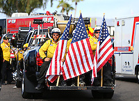 Feb 26, 2017; Chandler, AZ, USA; NHRA safety safari members hold American flags during the Arizona Nationals at Wild Horse Pass Motorsports Park. Mandatory Credit: Mark J. Rebilas-USA TODAY Sports