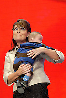 St. Paul, MN - September 3, 2008: Sarah Palin with her son Trig Palin, who has down syndrome onstage at the 2008 Republican National Convention at the Excel Center in St. Paul, Minnesota.