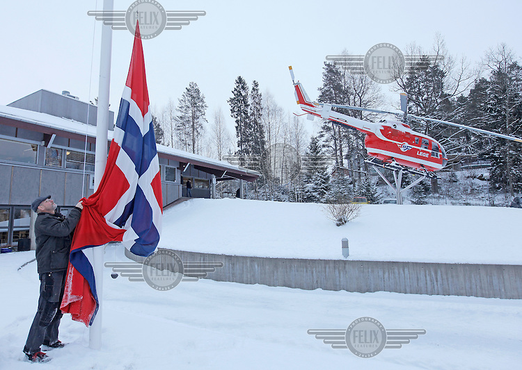 Flag being  flow at half mast at Norwegian Air Ambulance headquarters following a crash where a helicopter goes down after striking power lines. It was about to land at the site of a traffic accident. The pilot and doctor were killed, while the rescue paramedic was severely injured. <br /> The helicopter was an Eurocopter EC 135.