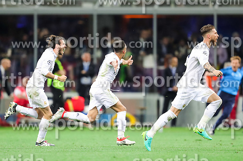 Gareth Bale of Real Madrid, Lucas Vázquez of Real Madrid and Sergio Ramos of Real Madrid celebrate after last penalty shot of Cristiano Ronaldo of Real Madrid at football match between Real Madrid (ESP) and Atlético de Madrid (ESP) in Final of UEFA Champions League 2016, on May 28, 2016 in San Siro Stadium, Milan, Italy. Photo by Vid Ponikvar / Sportida