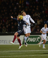 Lorient, France. - Sunday, February 8, 2015:  Abby Wambach (20) of the USWNT goes up for a header with Amandine Henry (6) of France. France defeated the USWNT 2-0 during an international friendly at the Stade du Moustoir.