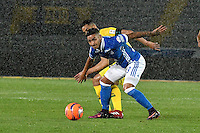 BOGOTA - COLOMBIA - 12 - 02 - 2017: Cristian Arango (Der.) jugador de Millonarios disputa el balón con Yulian Anchico (Izq.) jugador de Atletico Bucaramanga, durante partido de la fecha 3 entre Millonarios y Atletico Bucaramanga, de la Liga Aguila I-2017, jugado en el estadio Nemesio Camacho El Campin de la ciudad de Bogota.  / Cristian Arango (R) player of Millonarios vies for the ball with con Yulian Anchico (L) player of Atletico Bucaramanga, during a match between Millonarios and Atletico Bucaramanga, for the date 3 of the Liga Aguila I-2017 played at the Nemesio Camacho El Campin Stadium in Bogota city, Photo: VizzorImage / Luis Ramirez / Staff.
