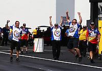 Jun. 2, 2013; Englishtown, NJ, USA: NHRA crew members for pro mod driver Mike Janis celebrate his victory during the Summer Nationals at Raceway Park. Mandatory Credit: Mark J. Rebilas-