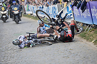 While chasing race leader Philippe Gilbert up ahead, Peter Sagan (SVK/Bora-Hansgrohe) hits a fence and crashes up the Oude Kwaremont, taking other race favorites Greg Van Avermaet (BEL/BMC) &amp; <br /> Oliver Naesen (BEL/AG2R-LaMondiale) down with him<br /> <br /> 101th Ronde Van Vlaanderen 2017 (1.UWT)<br /> 1day race: Antwerp &rsaquo; Oudenaarde - BEL (260km)