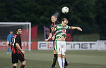 Bohemians defender Glenn Cronin wins an aerial dual with opponent Scott Ruscoe at Park Hall Stadium, Oswestry during his team's Champions League 2nd qualifying round 2nd leg game away to The New Saints. Despite leading 1-0 from the first leg, the Dublin club went out following their 4-0 defeat by the Welsh champions. The match was the first-ever Champions League match in the UK played on an artificial pitch and was staged at the Welsh Premier League's ground which was located over the border in England.