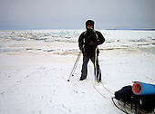 Justin first day across frozen Lake Baikal in Siberia, Russia. .They are a group of five people: Justin Jin (Chinese-British), Heleen van Geest (Dutch), Nastya and Misha Martynov (Russian) and their Russian guide Arkady. .They pulled their sledges 80 km across the world's deepest lake, taking a break on Olkhon Island. They slept two nights on the ice in -15c. .Baikal, the world's largest lake by volume, contains one-fifth of the earth's fresh water and plunges to a depth of 1,637 metres..The lake is frozen from November to April, allowing people to cross by cars and lorries.