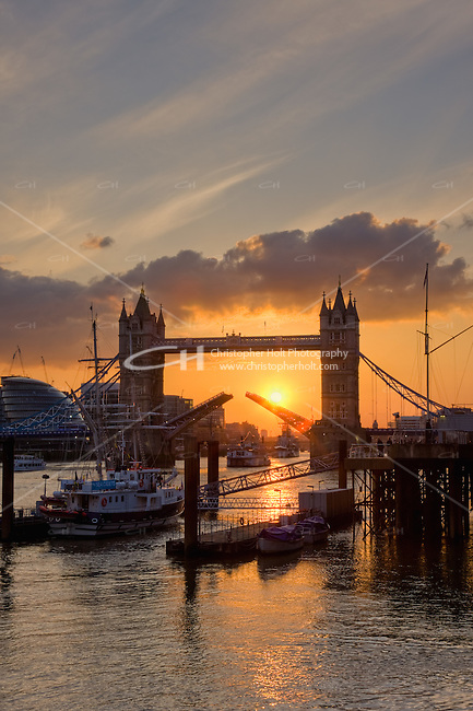 sun setting behind tower bridge in april 2010