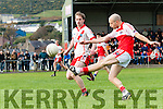 Daingean Uí Chúis Pól Ó Dubhain kicking the ball closely watched by An Ghaeltacht Padraig Ó Sé during the West Kerry Senior Championship Final at Pairc an Aghasaigh, Dingle, on Sunday afternoon.