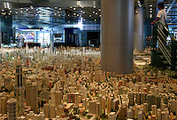 Visitors look at a model map of what municipal planners hope Shanghai will eventually look like at the Shanghai City Planning Museum in Shanghai, China. Already a city of 20 million residents, Shanghai is well on its way of becoming one of the major metropolis of the world..14 Sep 2004