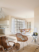 The large open-plan space has three distinct areas for dining, living and kitchen
