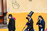 Young couples, costumed as 'La Catrina', a Mexican pop culture icon representing the Death, walk through the town during the Day of the Dead celebration in Morelia, Michoacán, Mexico, 1 November 2014. Day of the Dead ('Día de Muertos') is a syncretic religious holiday, celebrated throughout Mexico, combining the death veneration rituals of the ancient Aztec culture with the Catholic practice. Based on the belief that the souls of the departed may come back to this world on that day, people gather on the gravesites praying, drinking and playing music, to joyfully remember friends or family members who have died and to support their souls on the spiritual journey.