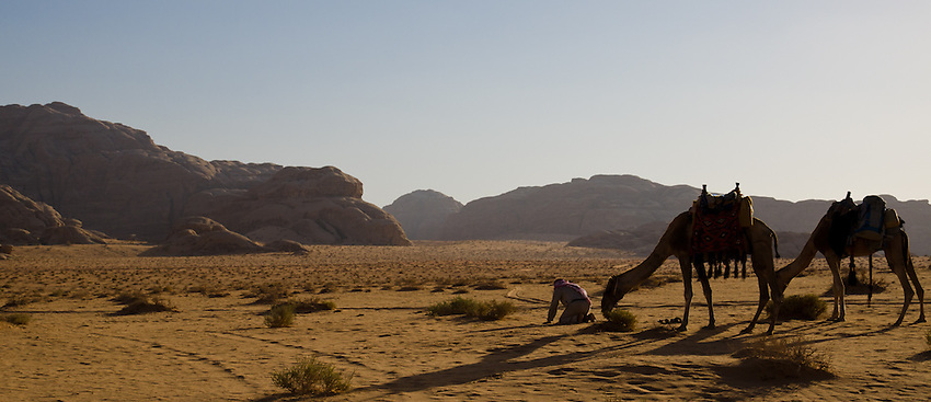 A Bedouin guide in Wadi Rum pauses to pray, facing south toward Mecca. Many Bedouins have left their lives as herders and turned to tourism for their livelihoods.