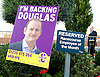 UKIP National Party Conference <br /> Day 2<br /> at Doncaster Race Course, Doncaster, Great Britain <br /> 27th September 2014 <br /> <br /> Douglas Carswell poster <br /> next to Employee of the Month sign <br /> <br /> Photograph by Elliott Franks <br /> Image licensed to Elliott Franks Photography Services
