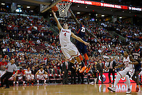 Ohio State Buckeyes guard Aaron Craft (4) scores two against Illinois Fighting Illini guard Kendrick Nunn (25) in the send half at Value City Arena in Columbus Jan. 23, 2013 (Dispatch photo by Eric Albrecht)