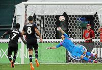 Washington D.C. - July 21, 2014:  Eddie Johnson (7) of D.C. United takes a penalty kick against Dan Kennedy of Chivas USA. D.C. United defeated the Chivas USA 3-1 during a Major League Soccer match for the 2014 season at RFK Stadium.