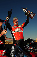 Oct. 30, 2011; Las Vegas, NV, USA: NHRA pro stock motorcycle rider Eddie Krawiec celebrates after winning the Big O Tires Nationals at The Strip at Las Vegas Motor Speedway. Mandatory Credit: Mark J. Rebilas-