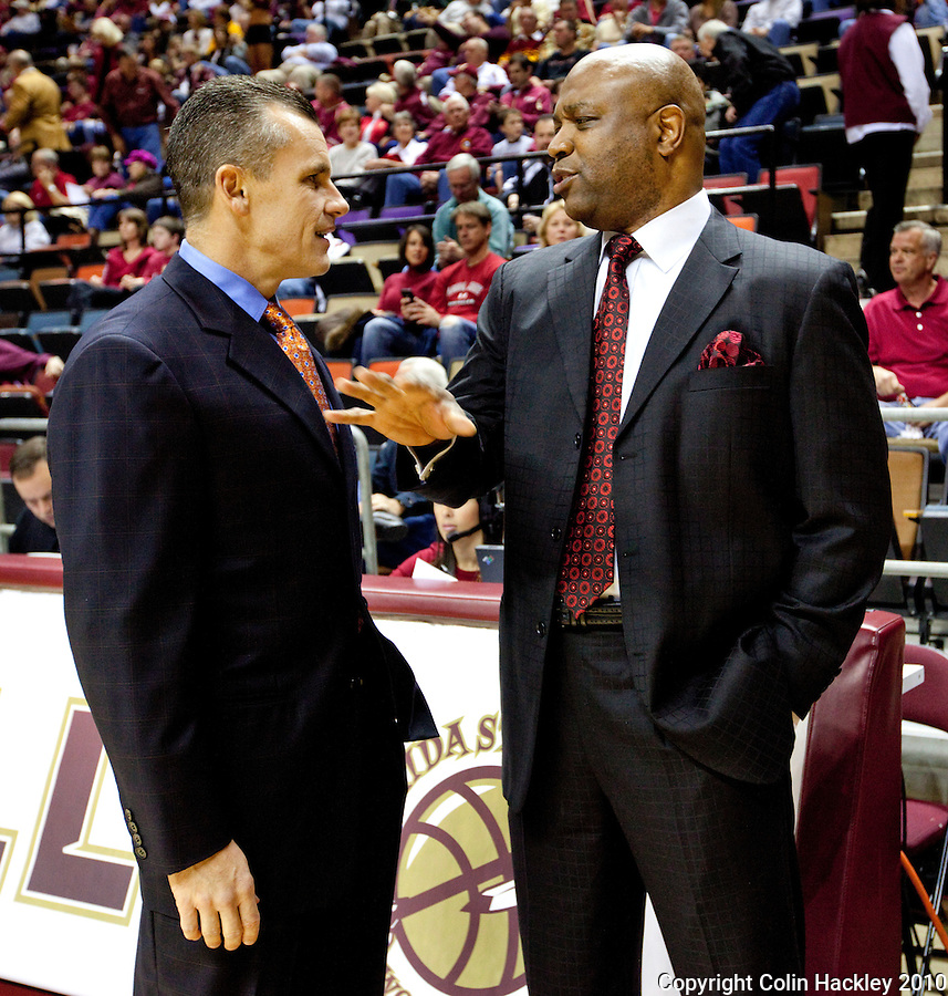 TALLAHASSEE, FL 09-FSU-UF MBB10 CH-Florida State Head Basketball Coach Leonard Hamilton, right, talks with Florida Head Basketball Coach Billy Donovan prior to the game Sunday at the Donald L. Tucker Center in Tallahassee...COLIN HACKLEY PHOTO