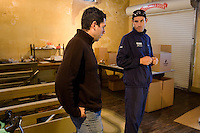 Discovery Channel Pro Cycling Team racer George Hincapie (right) and his brother Rich talk at their business, Hincapie Sportswear. Long successful in the European classics, in addition to being Lance Armstrong's right hand man on the team, Hincapie took his first Tour de France stage win in 2005.<br />