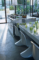 White Verner Panton chairs line the table in the open-plan kitchen/dining area