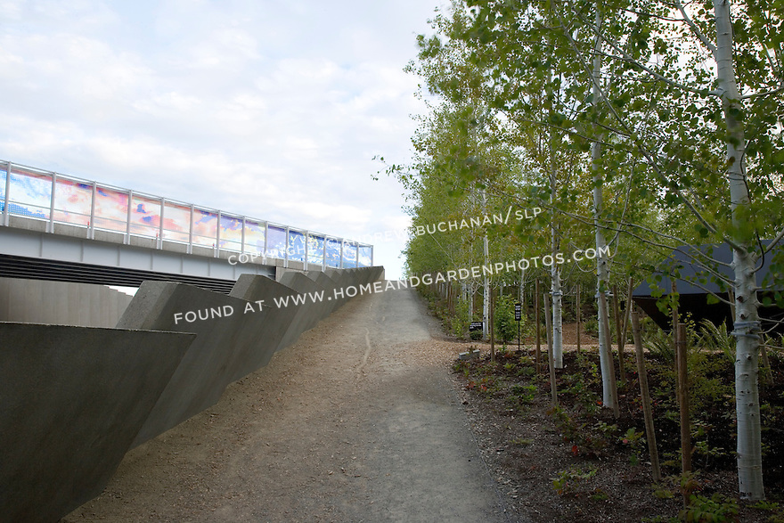 Teresita Fernandez's 'Seattle Cloud Cover', 2004-06 edges the sky bridge over the railroad tracks, while Tony Smith's 'Wandering Rocks', 1967-74 hides among the aspens at the sculpture park.