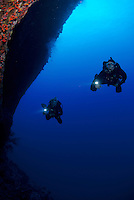Two tecnical divers on the back wall molokini maui hawaii.