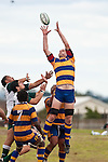 Rees Logan reaches for the ball from a restart as the Manurewa forwards arrive. Counties Manukau Premier Club Rugby game between Manurewa and Patumahoe played at Mountfort Park Manurewa on Saturday 3rd April 2010..Patumahoe won 26 - 8 after leading 14 - 3 at halftime.